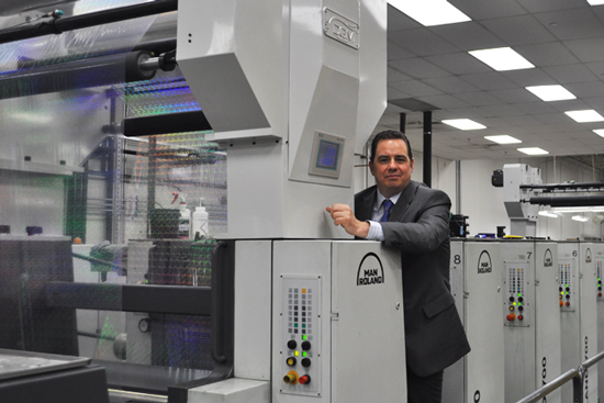 DGM President Michael DeBard and Foildex on a manroland press
