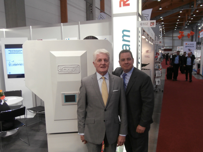 John Hopkinson and Michael DeBard of Diversified Graphic Machinery in front of Foildex Cold Foil Indexing System