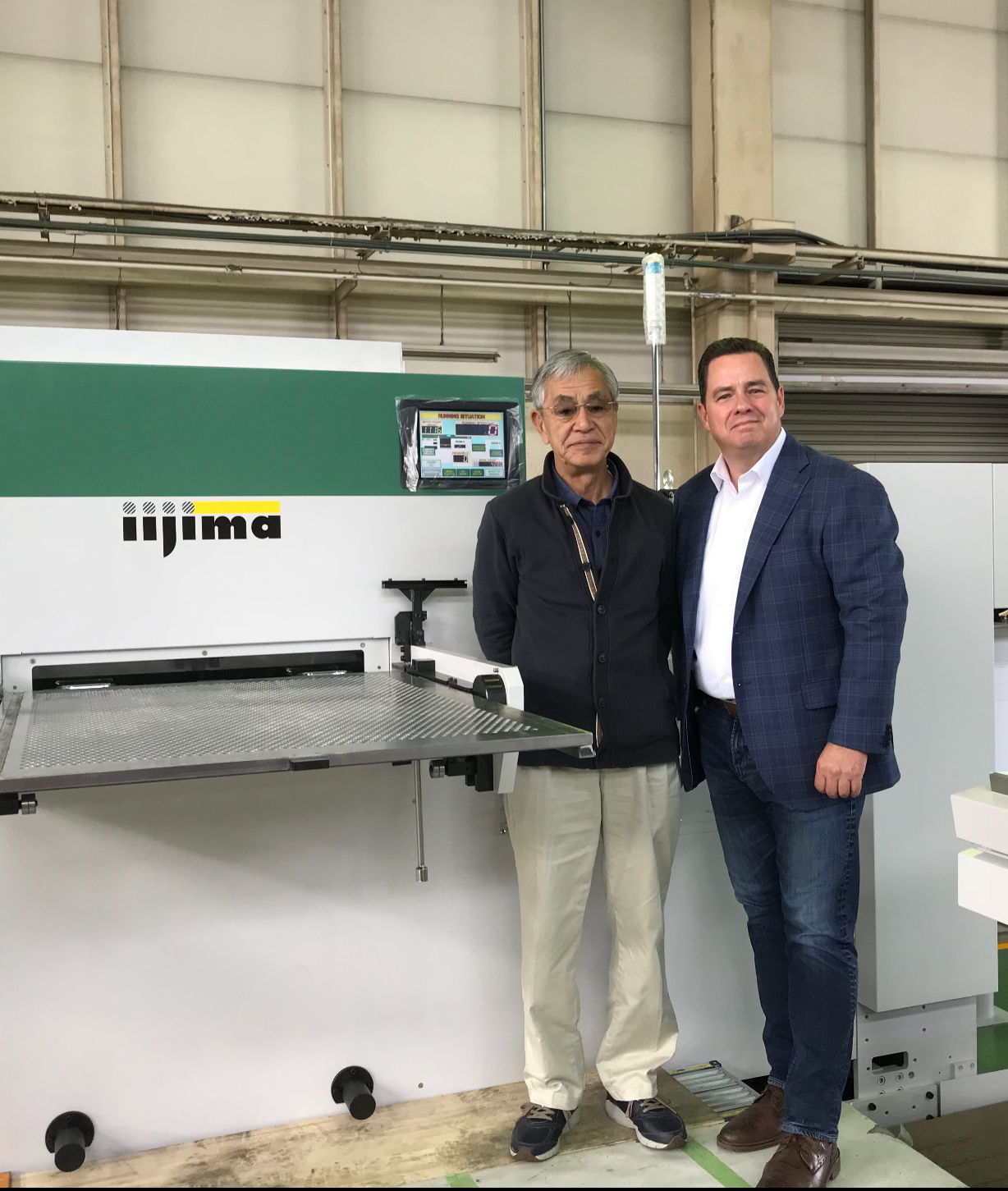 Mr.-Iijima-and-Michael-DeBard-at-the-Iijima-Factory-in-Japan